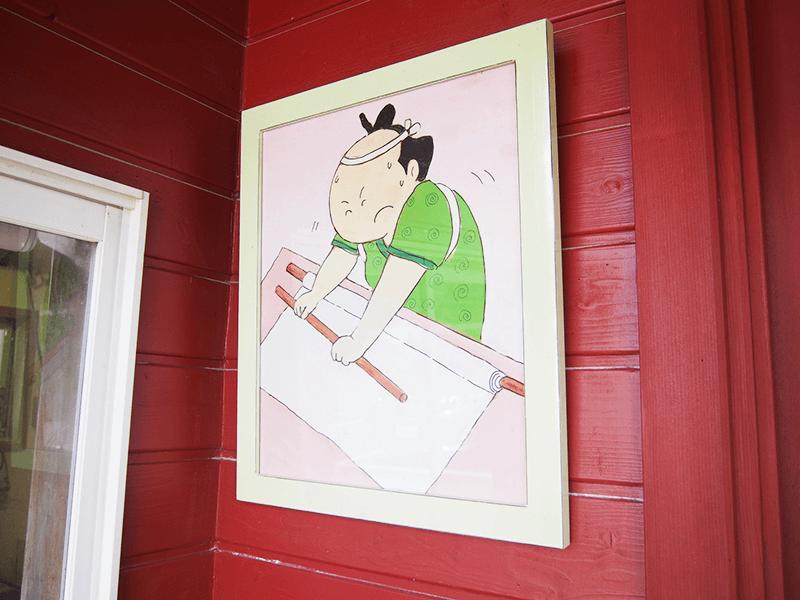 こちらはお店の入り口に飾られた絵。シンプルな線に、福井さんの遊び心が表れています